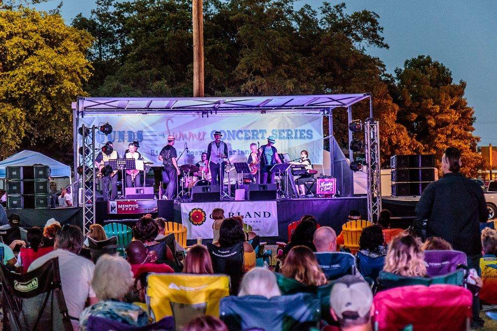 Sounds of Summer Concert Series stage image with band